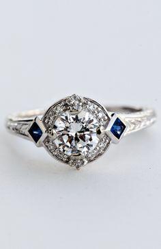 R5657E #vintage #sapphire #halo #diamond #whitegold #wilsondiamonds