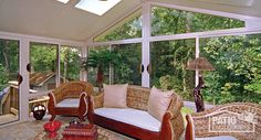 Three season sunroom with a sandstone aluminum frame with gable roof. #sunrooms #homeimprovement
