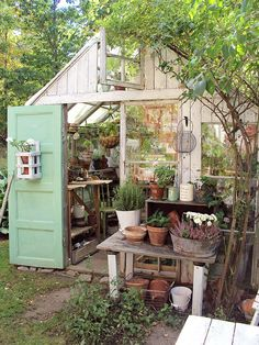Garden shed built using repurposed vintage doors and windows! Garden shed built using repurposed vintage doors and windows! Bebe& Love this potting shed and potting bench outside the front door! Greenhouse Shed, Greenhouse Gardening, Simple Greenhouse, Greenhouse Wedding, Window Greenhouse, Portable Greenhouse, Balcony Gardening, Design Jardin, Garden Design