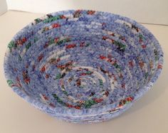 A personal favorite from my Etsy shop https://www.etsy.com/listing/479529625/fabric-pottery-coiled-fabric-bowl-basket