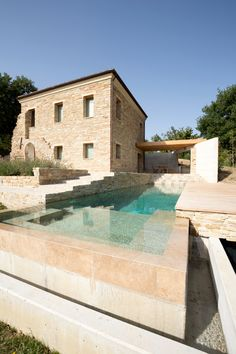 If only this was my holiday home. Beautiful minimal pool and traditional stone house