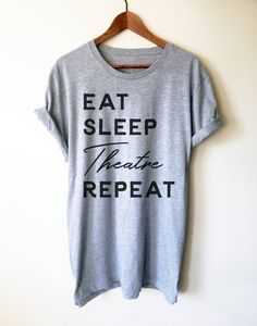 We love this Eat Sleep Theatre Repeat shirt as a gift for the theater lover in