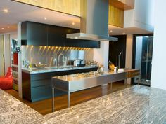 Top-of-the-line countertop materials and stainless-steel appliances create a sleek, modern mood in the kitchen.