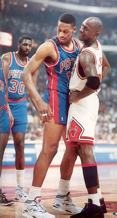 Michael Jordan and Dennis Rodman. Haha, not a single tat on Rodman yet.