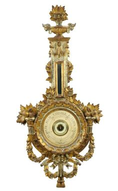 A LOUIS XVI STYLE CARVED GILTWOOD BAROMETER : Lot 89