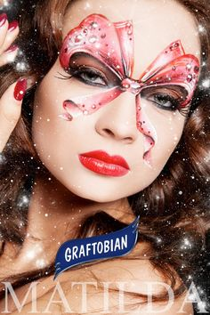 Creative red bow inspired fantasy make-up accented with crystals bt Graftobian HD Make-up.