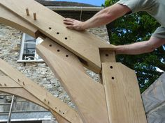 Traditional arched brace truss joinery. Green oak.