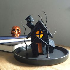The @clumberjacks crafted this crooked house for #Halloween out of a craft store mini-birdhouse. Genius! #glitter #diy #craft