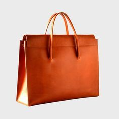 tan leather briefcase                                                                                                                                                                                 More