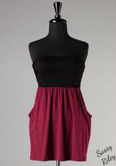 Ready for the Game -- Black/Crimson You'll be ready in a jiff for the game in this stylish tube top dress or top! And did we forget to mention....it has pockets. This dress will look great with flats or boots and even as a top with a pair of jeans!