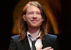 Domhnall Gleeson (born 12 May 1983) is an Irish actor, director, and writer and portrayed Bill Weasley in the Harry Potter films. Gleeson is the son of  Brendan Gleeson, who played Mad 'Eye' Moody.