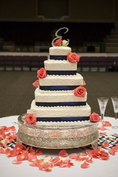 Navy and coral pink wedding cake with monogram on top
