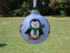 Hand Painted Glass Ornament with penguins no96 by ADragonflysFancy