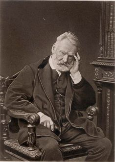 Victor Hugo.  A romantic realist.  As evidenced by the epic beard.