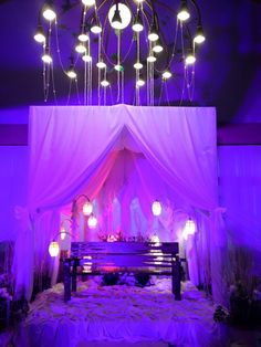 Joy and Rey wedding reception! Alluring use of white drapes with beads and twigs.