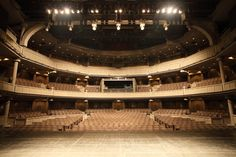 """Globe Tokyo retains some aspects of the famous Elizabethan structure—most notably, the three tiers of audience seats in a circular shape. Instead of the midsized thrust, however, there is a large proscenium stage that flattens part of the """"O."""" The interior and amenities are also very modernized."""