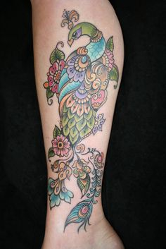 i normally am not a fan of coloured tattoos...but this is pretty neat...