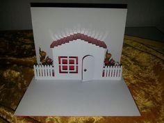 eine 3D-Umzugskarte mit kleinem Häuschen und Gartenzaun.