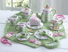 Crochet Tea SetCreative play takes on a new meaning with this magnificent Crochet Tea Set Pattern. This full tea set designed by Donna Collinsworth includes a teapot with lid, sugar bowl with lid, creamer, saucers, cups, cake plates, cake slice, tea bags, lemon slices, spoons and carrying bag. The crochet design includes wh