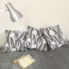 Large hand screen printed limited edition cushion with 'Sediment Mono' design. Reverse charcoal grey velvet. 53x53cm