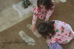 Baking soda + glitter = Santa's Footprints ...just another way to make Christmas morning a bit more magical.  ;)