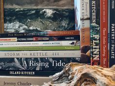 (From horizontal stack) Wildness by Jermy Charles. Island Kitchen: an ode to Newfoundland by Chef Mark McCrowe + Sasha Okshevsky. A Rising Tide: a cookbook of recipes & stories from Canada's Atlantic Coast, by DL Acken & Emilu Lycopolus. Storm the Kettle: resetting the Newfoundland table, by Elaine Feore and Joanne Goudie. A real Newfoundland Scoff: Using traditional ingredients in today's kitchens by Liz Feltham. Some Good: nutritious Newfoundland Dishes by Jessica Mitton. Another Newfoundland Newfoundland Recipes, Island Kitchen, Nova Scotia, The Rock, Kettle, Family Meals, Coastal, Kitchens, Canada