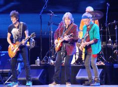 "Ronnie, Mick Taylor, Keith and Charlie during ""Midnight Rambler."""