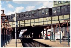 M train leaving the Myrtle/Broadway Station on the High Track.