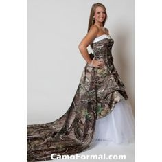 Sweetheart a-line pickup dress with net skirt.Roses Detachable train included.Highlighted with a waterfall rhinestone pin.Pictured in Realtree APG Camo and White Net wearing a full slip.Available in all camo patterns and in sizes 2-30.Made in the USA.Camo Wedding Prom Grad Outdoor Weddings Country Western Hunters