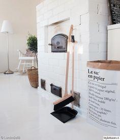 keinutuoli,olohuone,keittiö,valkoinen lattia,oliivipuu