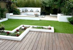 I really like the clean lines in this garden, and the different textures. I agree with this pinner, I'd like to do this white boxing around the grass area. Maybe plant berry bushes