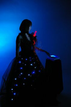 Mysterious Night Flower - lilypad arduino, 255 LEDs. In once instance, members of the audience played a toy piano which in turn changed the patterns of light on the dress