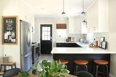 Functional small kitchen. Love the blackboard, pendant lites, black/white cabinets.