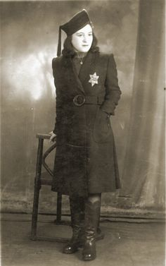 Studio portrait, taken in th Bedzin ghetto, of Mania Cawadel wearing a Jewish star. [Photograph #24889]