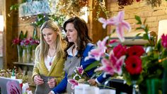 """Check out photos from the Hallmark Movies & Mysteries movie """"Flower Shop Mystery: Snipped in the Bud,"""" starring Brooke Shields, Brennan Elliott and Beau Bridges."""