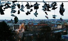 Shoes hang on a power line at Letna park overlooking Prague. Czech teenagers, who skateboard at the park, throw their unwanted shoes over the wire for fun at the city's main skating hangout. Photograph: Petr Josek/Reuters