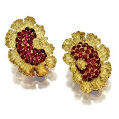 PAIR OF 18 KARAT GOLD AND RUBY EARCLIPS, BUCCELLATI Designed as stylized flowerheads set in the center with numerous cabochon rubies, the petals of textured gold, signed Buccellati.  With signed box.