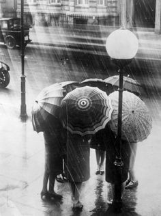 london rain [original] a group of women stand underneath umbrellas in the london rain, 1928. © general photographic agency/ getty images