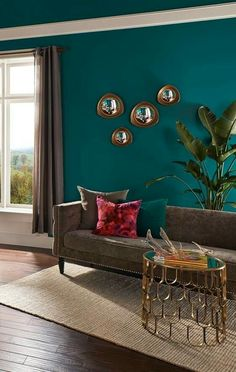 A rich teal hue of Behr Premium Plus Ultra coats the walls and ceiling in this l. A rich teal hue of Behr Premium Plus Ultra coats the walls and ceiling in this luxe master bedroom seating area. Get more teal paint inspiration. Room Paint Colors, Paint Colors For Living Room, Paintings For Living Room, Teal Living Rooms, Living Spaces, Living Room Decor Green, Living Room Accent Wall, Teal Walls, Teal Bedroom Walls
