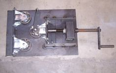 Flat Bar Roller by  -- Homemade flat bar roller constructed from casters, steel plate, flat bar stock, tubing, a nut, and threaded rod. http://www.homemadetools.net/homemade-flat-bar-roller