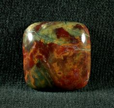 $18.50  Kaleidoscope jasper is found near Prineville Oregon. This piece has amazing patterns of red, green orange and yellow swirling together. A relatively new find, this material is absolutely gorgeous.