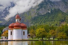 St. Bartholomä is a Catholic pilgrimage church in the Berchtesgadener Land district of Bavaria. The first chapel at this spot was built in 1134. It is named for Saint Bartholomew the Apostle, patron of alpine farmers and dairymen. The church is located at the western shore of the Königssee. It can only be reached by ship or after a long hike across the surrounding mountains.