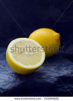 Close up of lemons above stone textured background
