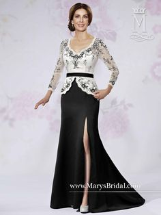 V-neck A-line mother-of-the-bride gown with a white long sleeve lace peplum bodice that has black embroidery and black satin belt, the black satin skirt with front slit and sweep train, and back zipper with buttons.
