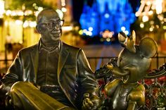 Roy O. Disney & Minnie Mouse at night in the Magic Kingdom. See the Hidden Mickey in the background? Read more about my gear: http://www.disneytouristblog.com/photography-camera-reviews-disney/