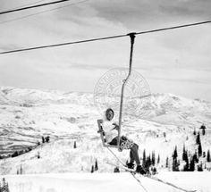 Woman on the Ogden City lift, Duret mountain in the background ::   Univ of Utah - Multimedia Archives Photographs    Skiing, Ski, Utah, Ogden, Snowbasin, Snow Basin