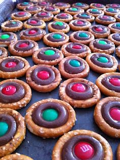 Salty & Sweet Pretzel Treats (Fill center with a Hershey Kiss.  225 oven. Take out as soon as the kisses are melted, but still hold their shape. Press one M ) can make this with gf pretzels