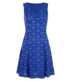 """This delicate lace design, in a rich blue hue is the ultimate piece for a special occasion this season. Grey heels complete the look.- V neckline- V back- Breathable lace fabric- Fit and flare design- Model is 5'8""""/176cm and wears UK 10/EU 38/US 6"""