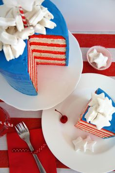 9 layer Independence Day red, white and blue cake, topped with homemade marshmallow stars