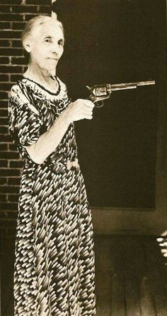 Pat Garrett's wife, holding the gun he used to kill Billy the Kid